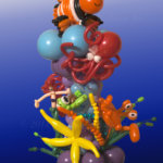 balloon decorator - balloon column with balloon artist under sea creations